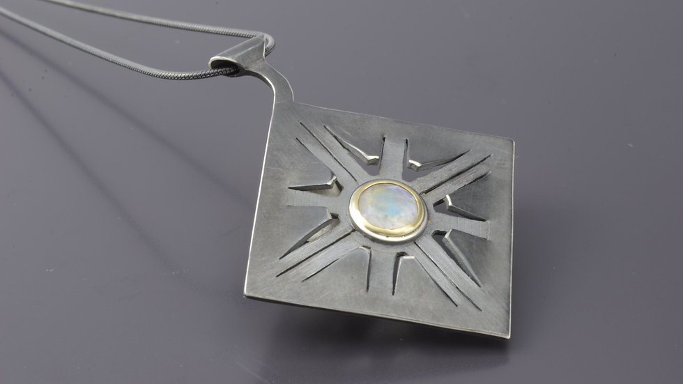 14k Gold and black silver Pendant with moonstone stone