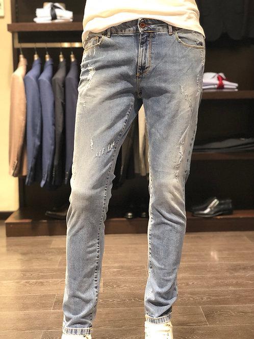 Jeans chiaro strappi