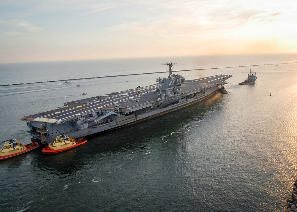 Decommissioned aircraft carrier USS John F. Kennedy begins its transfer to the Navy Inactive Ship Maintenance Facility in Philadelphia in 2007. (Tommy Gilligan/Navy)