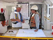 Truston's Marine Construction Supervisor and Ocean Engineer collaborate on a project onsite