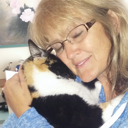 Deb and Patches reunion snuggle