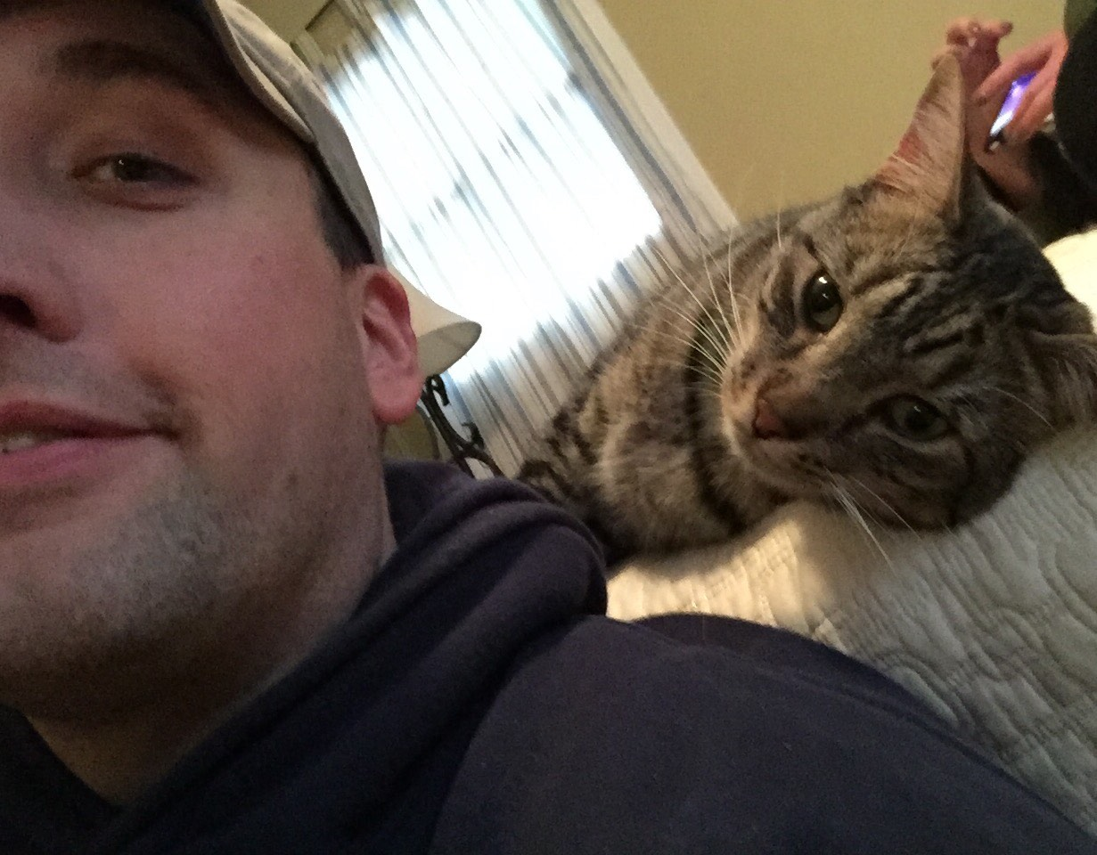Lost cat found home with John!