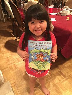 Little girl with book.jpg