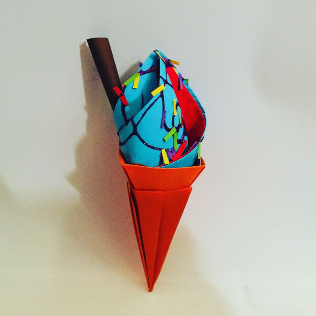 An ice cream cone, with glitter sauce & sprinkles.