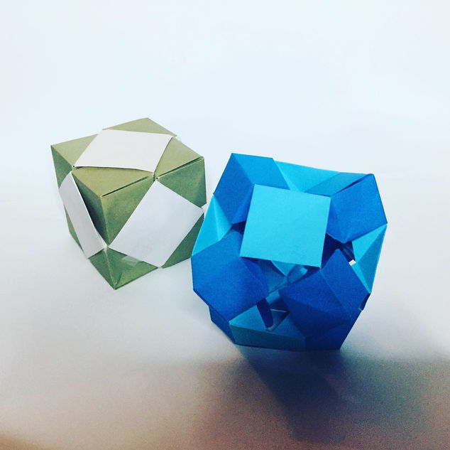 Skewbs ( Jeremy Schafer ) - They are cubes that can be skewed ... get it ? The Skewb on the left is fully closed, while the Skewb on the right is fully opened.