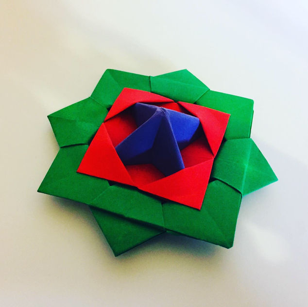 Origami Spinning Top. It's origami, it spins. I have posted videos of it spinning a little further down.