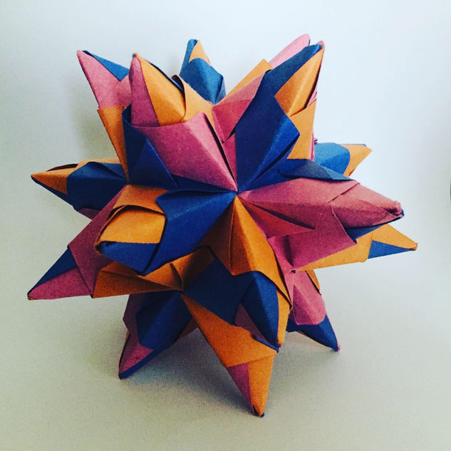 Bascetta star. Modular origami. This was nearly the end of me. Took me literally hours to put it together ( damn my clumsy hand ! ), but it looks really cool in real life.