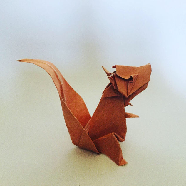 A squirrel ( Jo Nakashima ). Up to this point, by far the most technically challenging origami I had attempted. It's not perfect, with too much refolding, but I am proud of it.