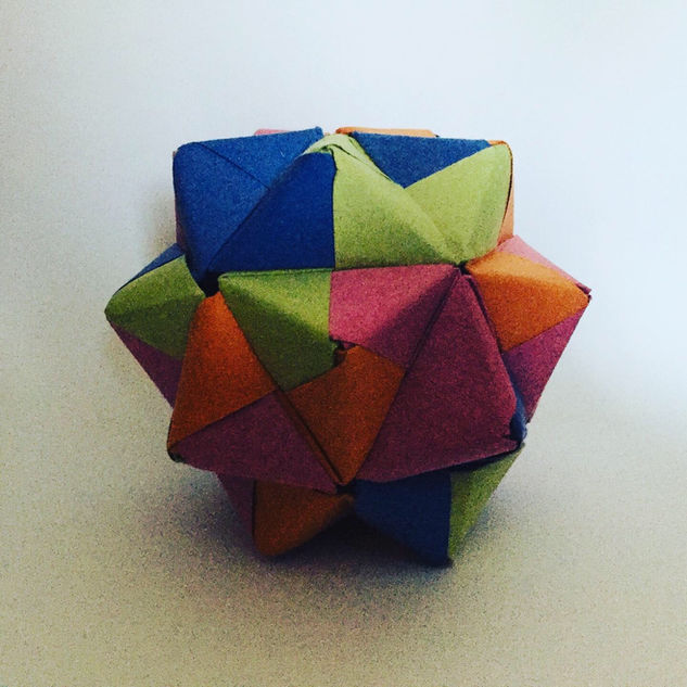 Modular origami. Made up of a number of the same-shaped, interlocking pieces. Look great. Took an age to make.