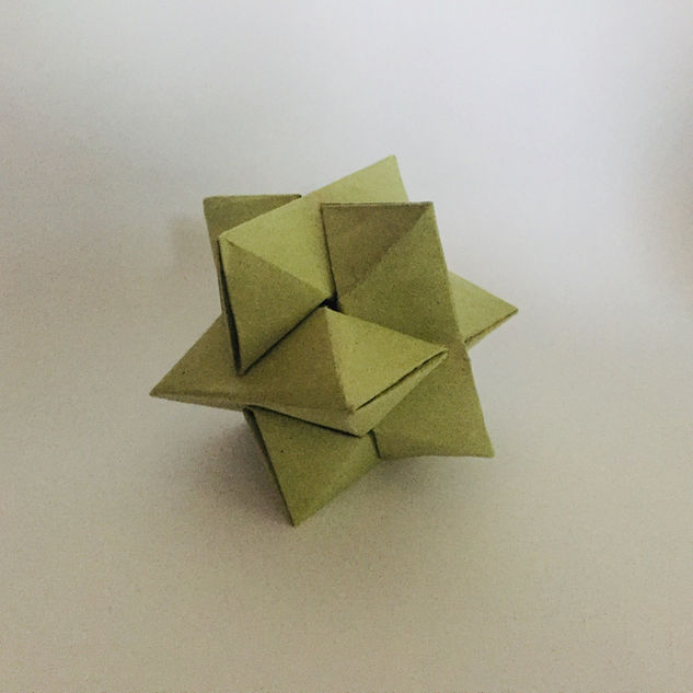 Burr puzzle ( unused ). A not particularly well-made origami puzzle, created uing really cheap paper.