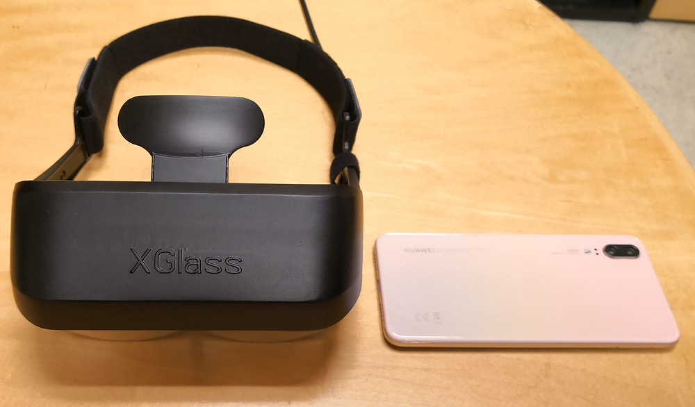 XGlass from iGlass USA inc looks very cool, with ultra-sharp image quality, and at 120g only