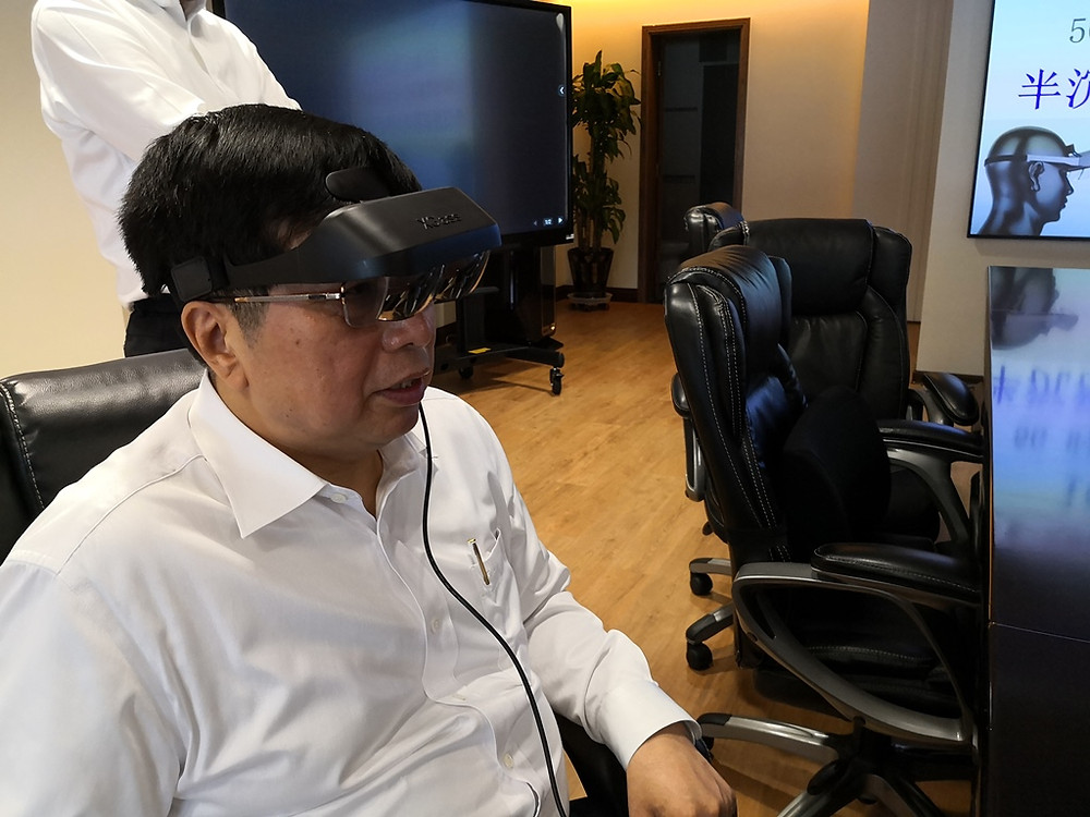 Hisense Chairman Mr. Zhou Houjian is really impressed by iGlass Ultra-sharp-and-vivid-image-quality, in Hisense Qingdao Headquarter