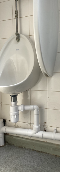 Commercial urinal waste pipe replacement.