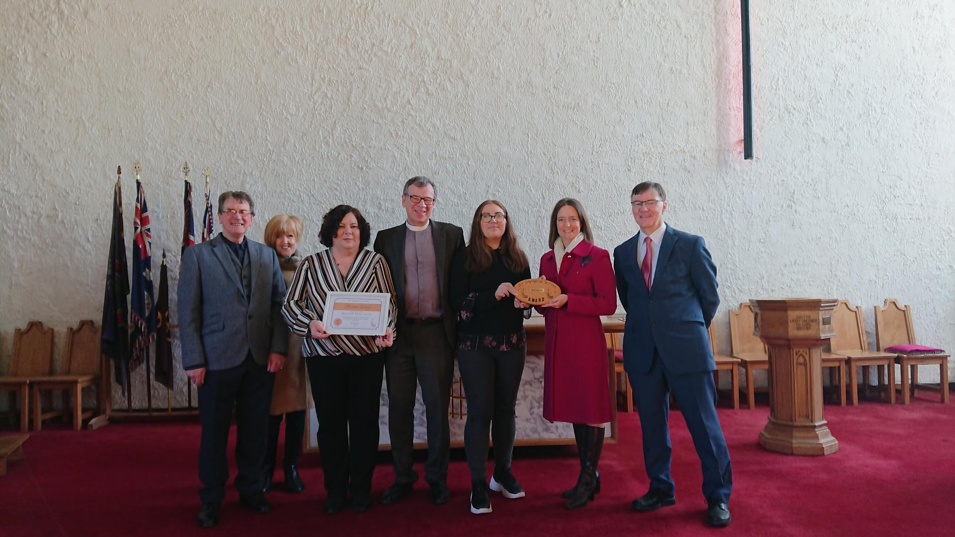 Presentation of Eco Congregation award by Carol Monaghan MP, Feb 2020:  L to R Frank and Isla Dick (Eco-Congregation Scotland), Lesleyanne Deans, Rev Melvyn Wood, Lucy Deans, Carol Monaghan, John Thomson (Session Clerk).