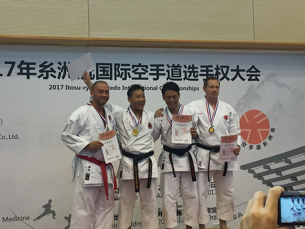 Daniel Tsumura receiving silver for Kata