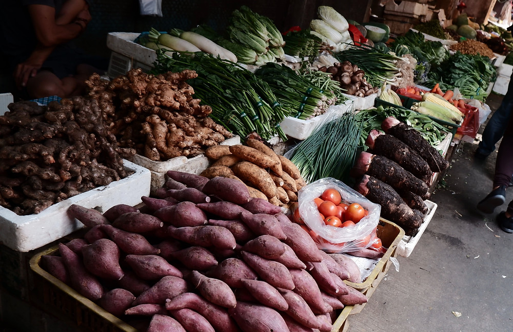 Buy food at a local vegetable market