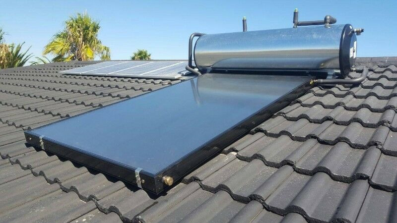 Silver solar geyser on tilled roof. Solar geyser can help save on the electricity bill