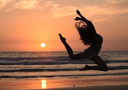 Woman jumpingonbeach2.jpeg