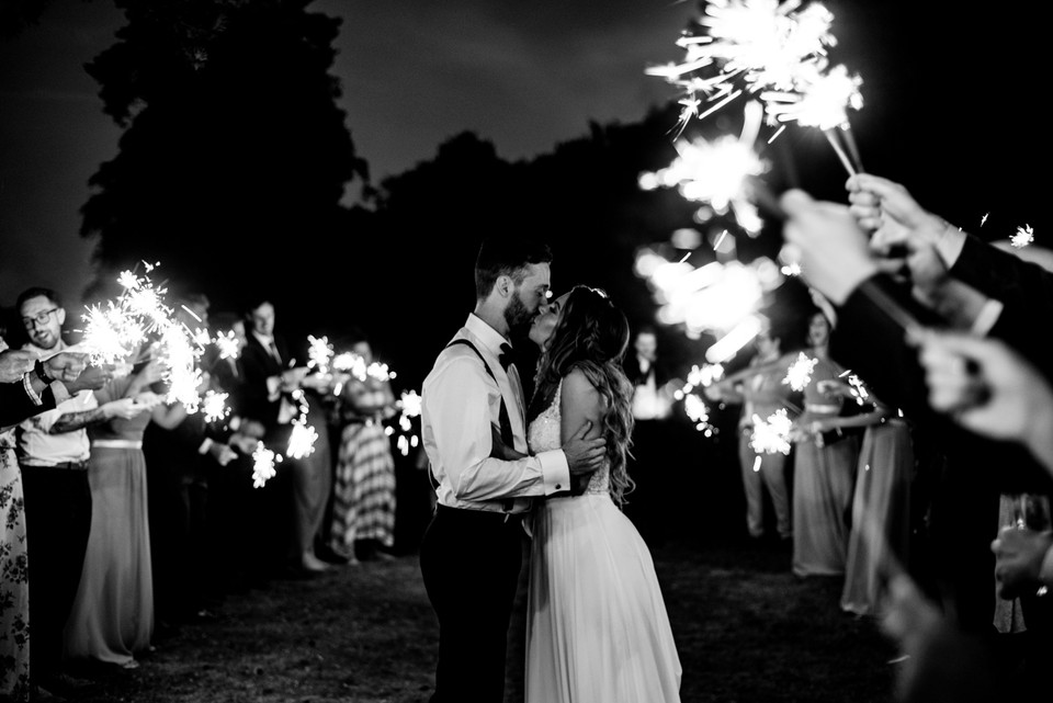 Couple kissing surrounded by sparklers