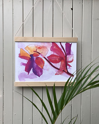 Framed art print of a design featuring pink and yellow flowers in a landscape view