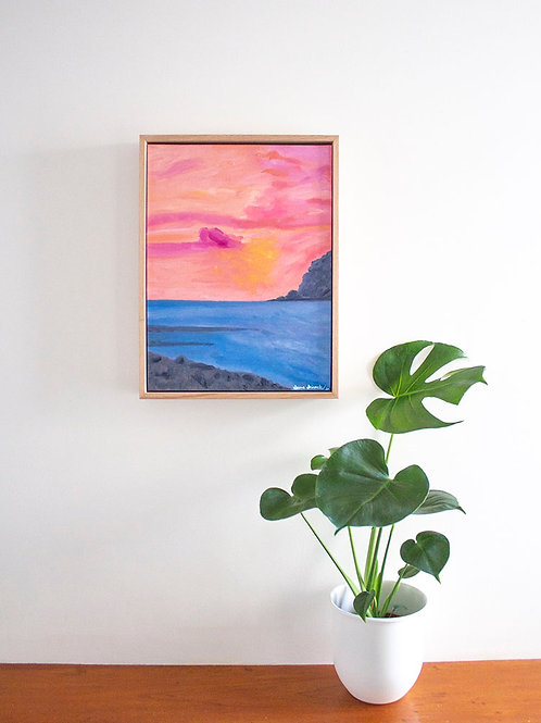 Framed original oil painting 'Coral Sunset' on wall with monstera plant