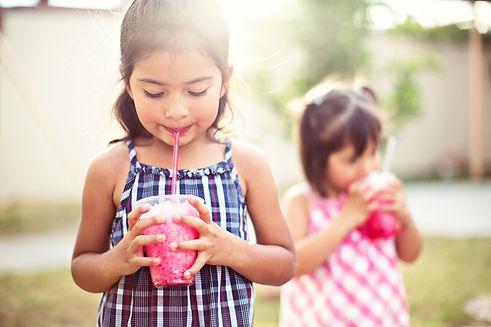 Children drinking slush drinks - Slush machine hire Essex - MMENT