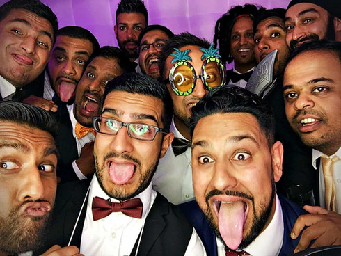 People having their photo taken in a photo booth - photo booth hire Essex - MMENT