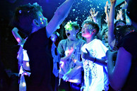 kids jumping at a party with a snow machine - Leavers discos Essex - MMENT