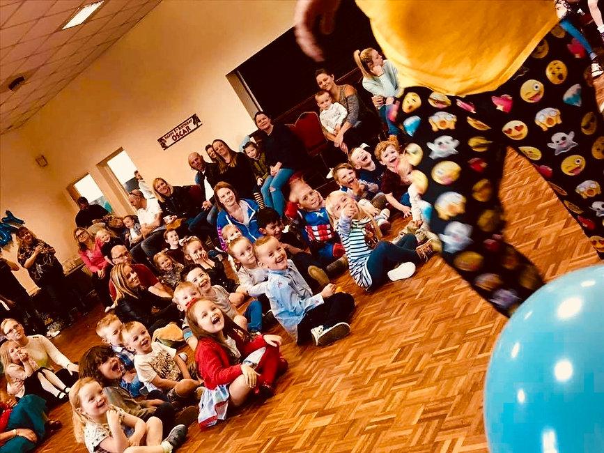 Children watching a party entertainer in Essex - Moji Entetainer