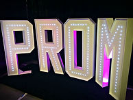 Light up letters spelling PROM - MMENT