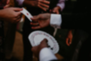 spectator taking a card from a magician - close magician hire Essex - MMENT