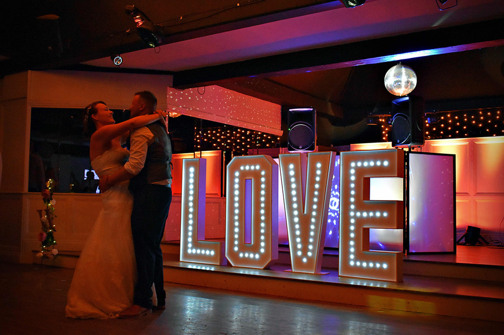 Light up Led letters spelling LOVE - light up letter hire Essex MMENT