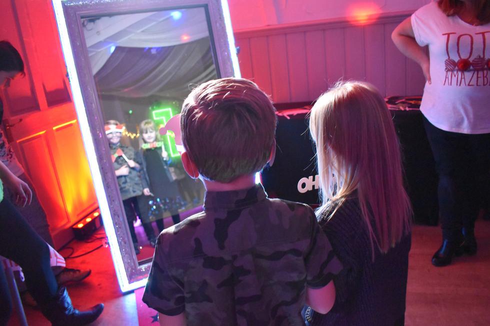 Magic selfie mirror photo booth taking pictures in Essex - Moji Eentertainer