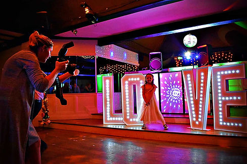 Gilr having picture taken with light up letters - light up letter hire Essex - MMENT