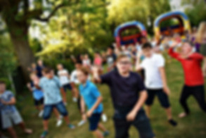 lots of children dancing at a kids party - Party DJ's for Kids in Essex - MMENT