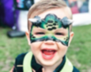 Child with face painted - professional face painter hire Essex - MMENT
