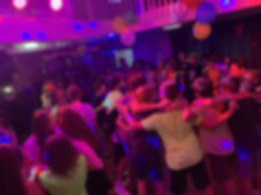 Children in a circle at a year 6 leavers disco in Essex - MMENT