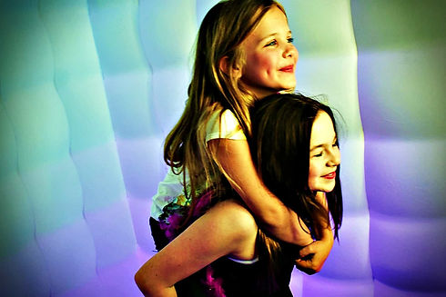 children in a photo booth in London - Moji Entertainer Essex