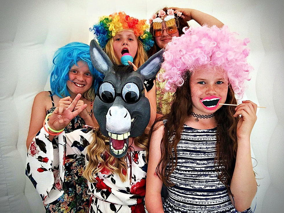 children using a photo booth in Essex - Photo booth hire - Moji Entertainer