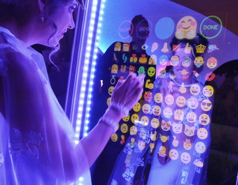 Bride signing her picture with a magic mirror - magic mirror photo booths for weddings Essex - MMENT