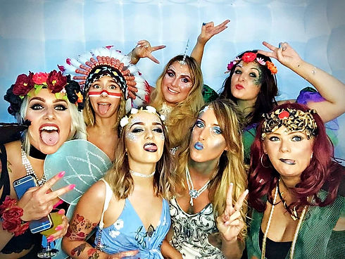 Group of girls haing their picture taken in a photo booth - photo booth hire Essex - MMENT