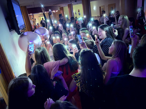 large group of teenagers taking photos at a party in Essex - Teen DJ Essex - MMENT