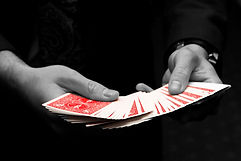 Close up magician fanning cards - Close up migician hire Essex - MMENT
