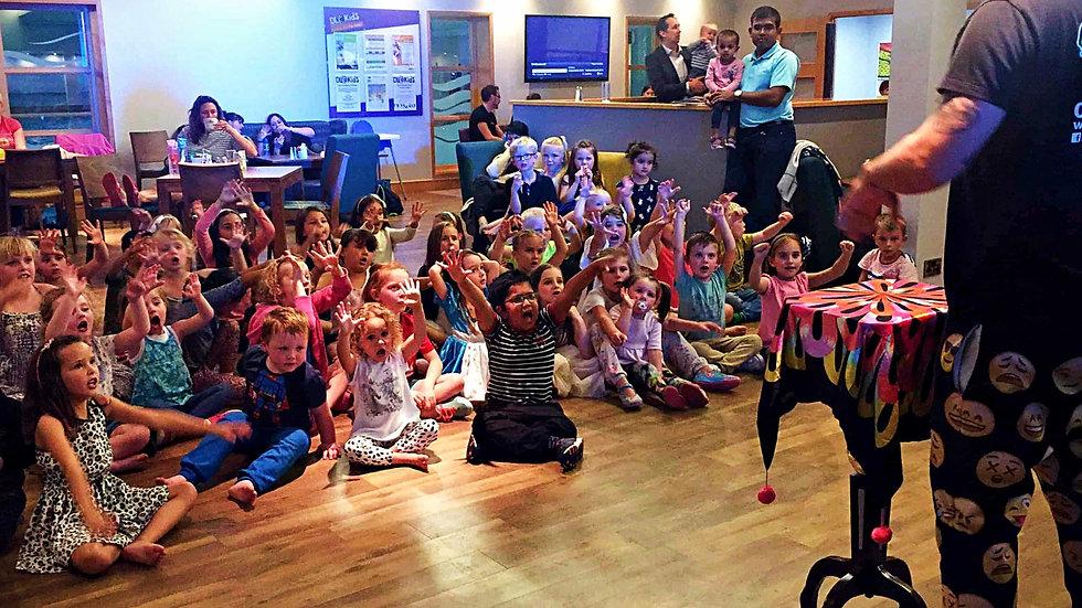 Children watching and entertainer perfom magic - Moji Entertainer Essex