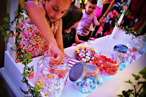 Children choosing sweets from a sweet cart - Sweet cart hire Essex - MMENT
