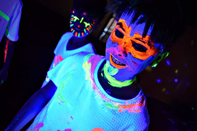 Boy at a glow in the dark party in Essex - Moji Entertainer