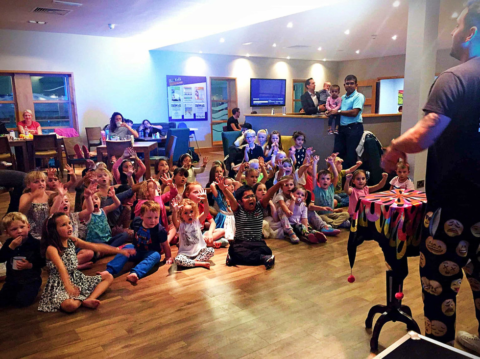 Xhildren watching a magic show - party entertainers in Essex - MMENT