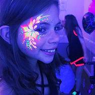 UV Face paint on a girls face - UV Face painting in Essex - Moji Entertainers