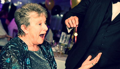 A spectators amazed reaction from a magic trick - close up magic in Essex - MMENT