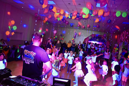 young children partying at a uv glow party in Essex - Moji